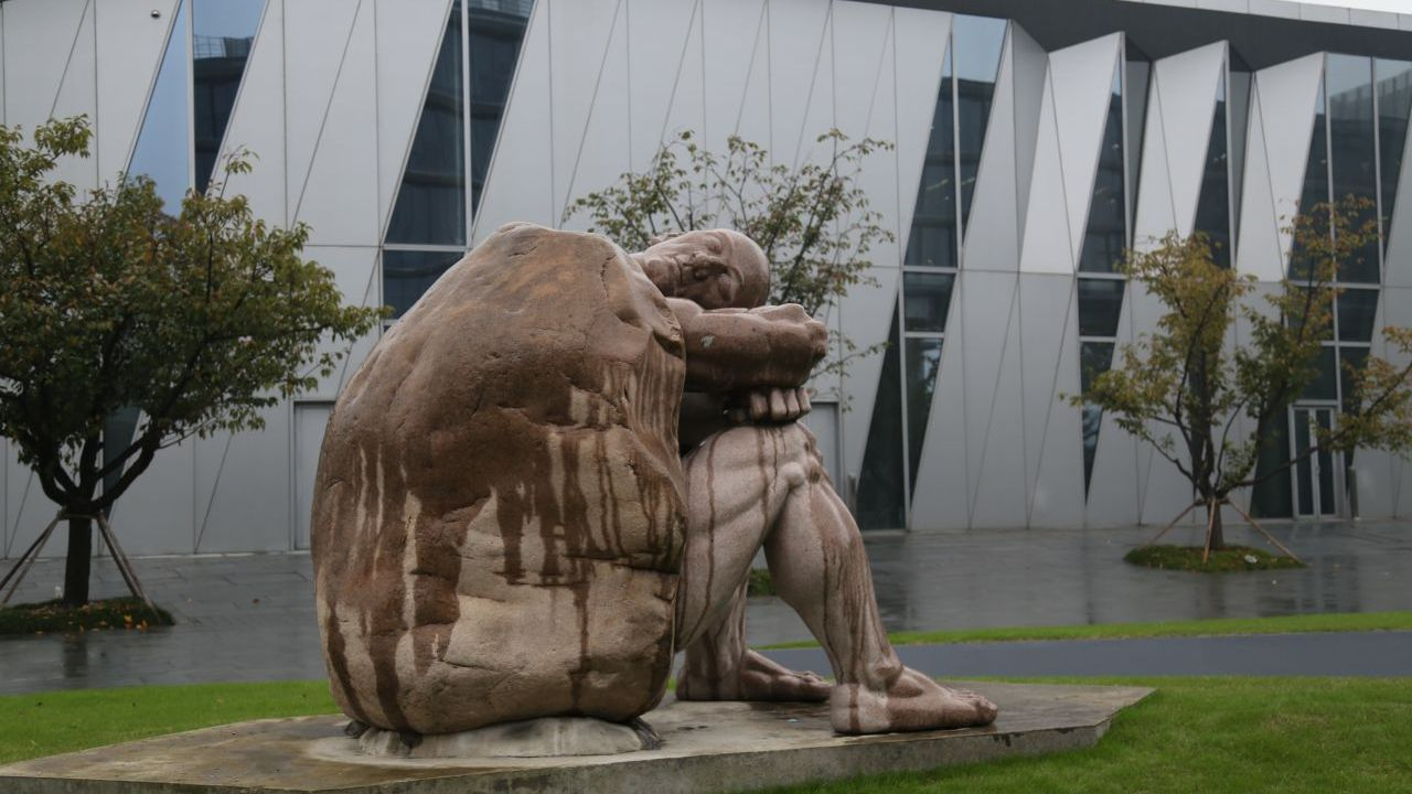 Statues litter Alibaba's headquarters. This one is designed to show that if humans stay still and stop thinking then they will turn to stone.