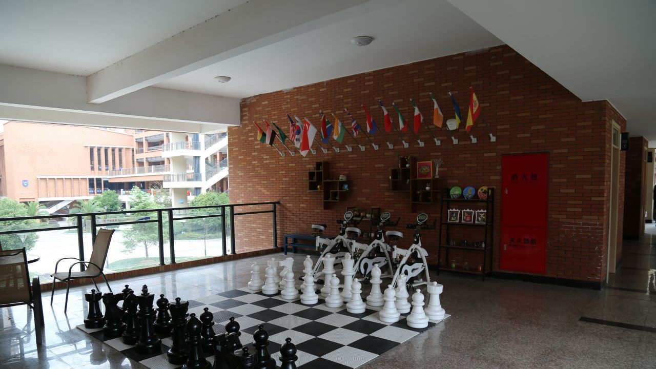 A large outdoor chess set allows students to hone their skills.