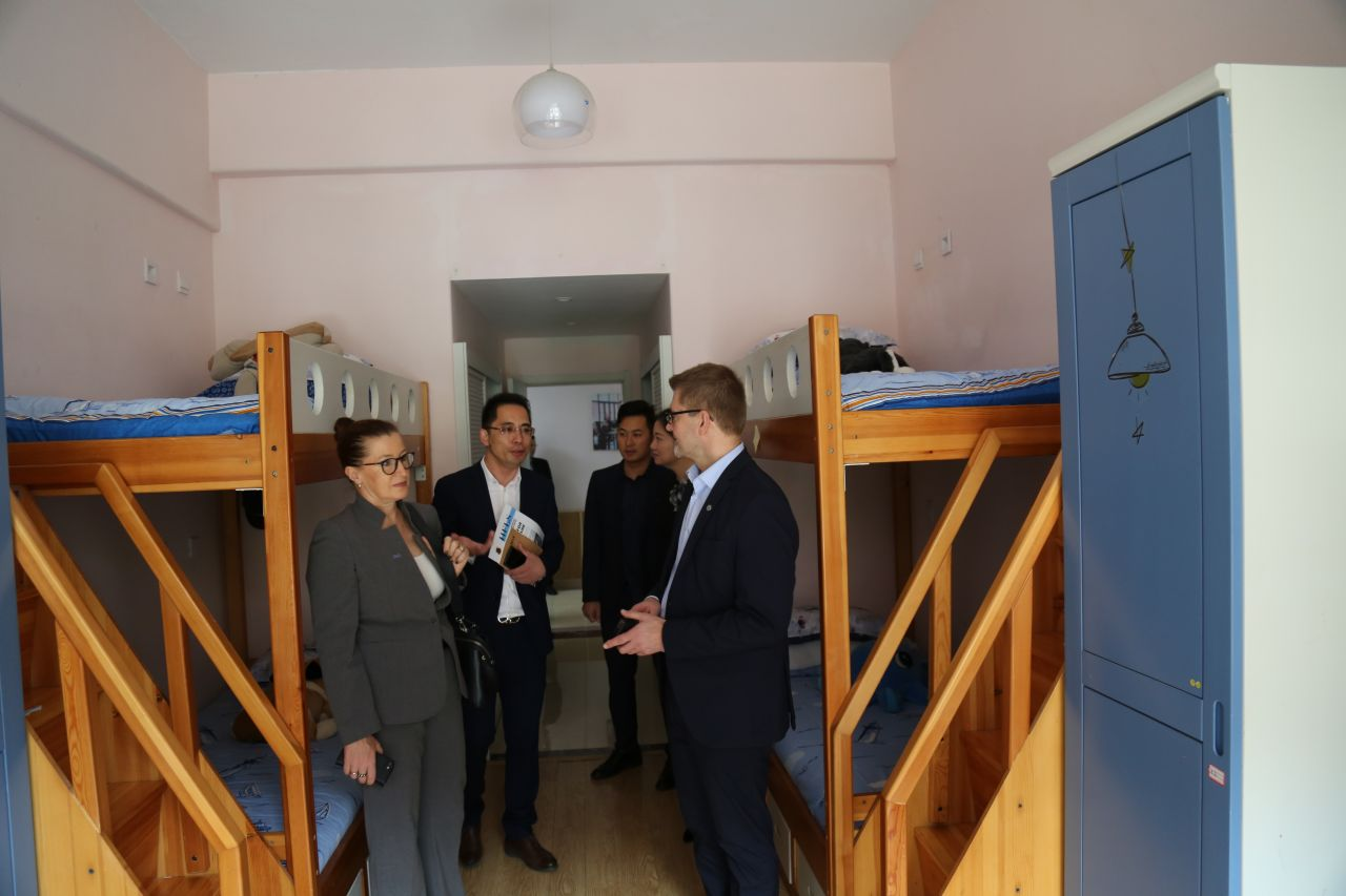 Lauri Tuomi and Pia Pakarinen are shown one of the school's typical dormitories.