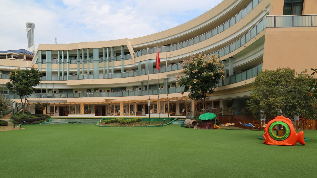 One side of the large kindergarten facility and its garden.