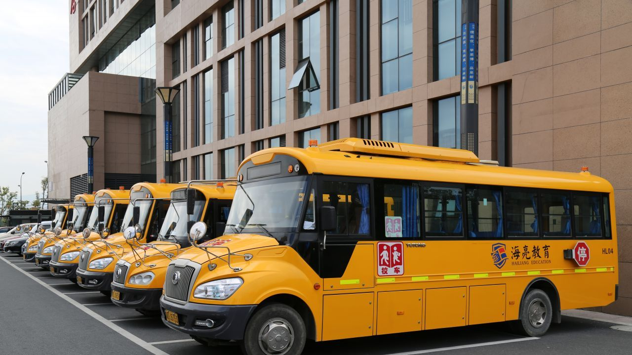 The school has more than 100 buses, which transfer its 15,000 students back and forth.