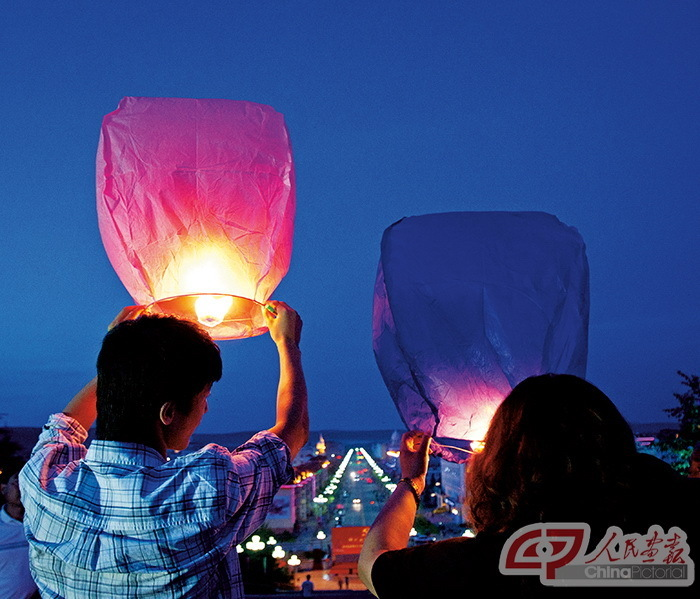 Paper lanterns are traditionally released the Chinese Mid-Autumn and Lantern festivals to pray for blessings.
