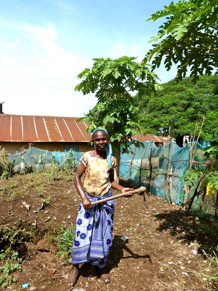 Woman working in the community garden in Kisumu, Kenya.