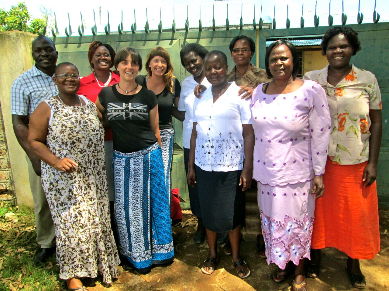 Mama Hope's global advocates Sydney Gray and Katrina Boratko with the staff of the Kenyan organization Our Lady of Perpetual Support.