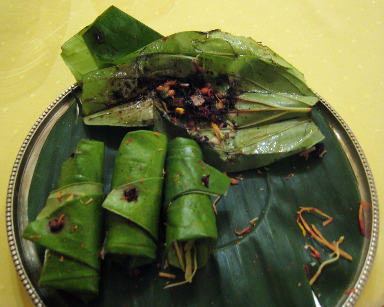 Paan is a preparation of betel leaf with areca nut and a number of spices, including for example menthol and tobacco. Paan is chewed and finally swallowed - or spat out.