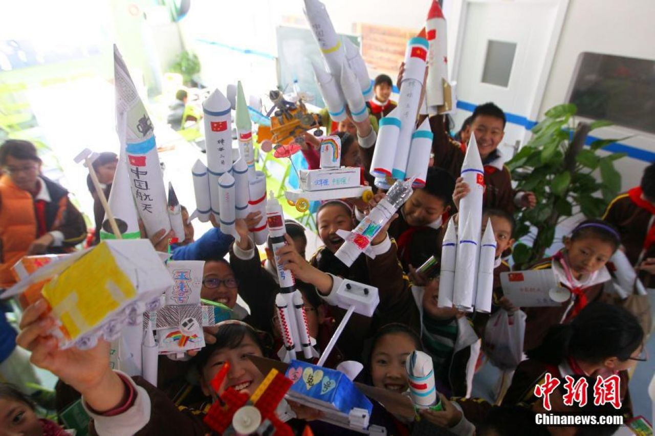 December 2, 2013: Elementary school students at a Haidian district school in Beijing make models of Jade Rabbit, Chang'e-3 and the Long March 3B rocket used to launch them.