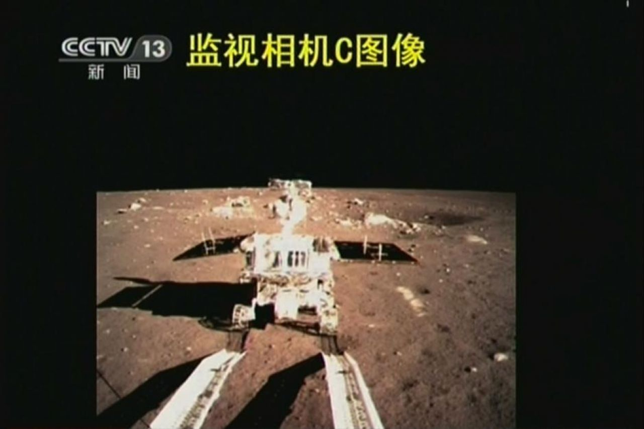 Yutu rolls onto the lunar surface, completing the rover's deployment on the moon.