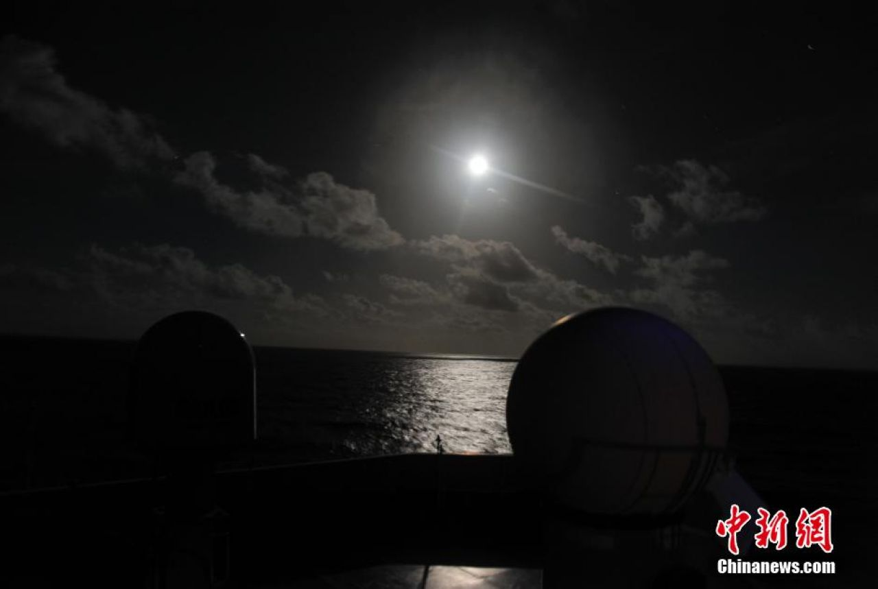 China's Yuanwang 6 space tracking ship  on December 17, 2013, under a full Moon shortly after the Chang'e-3 soft-landing on the lunar surface.