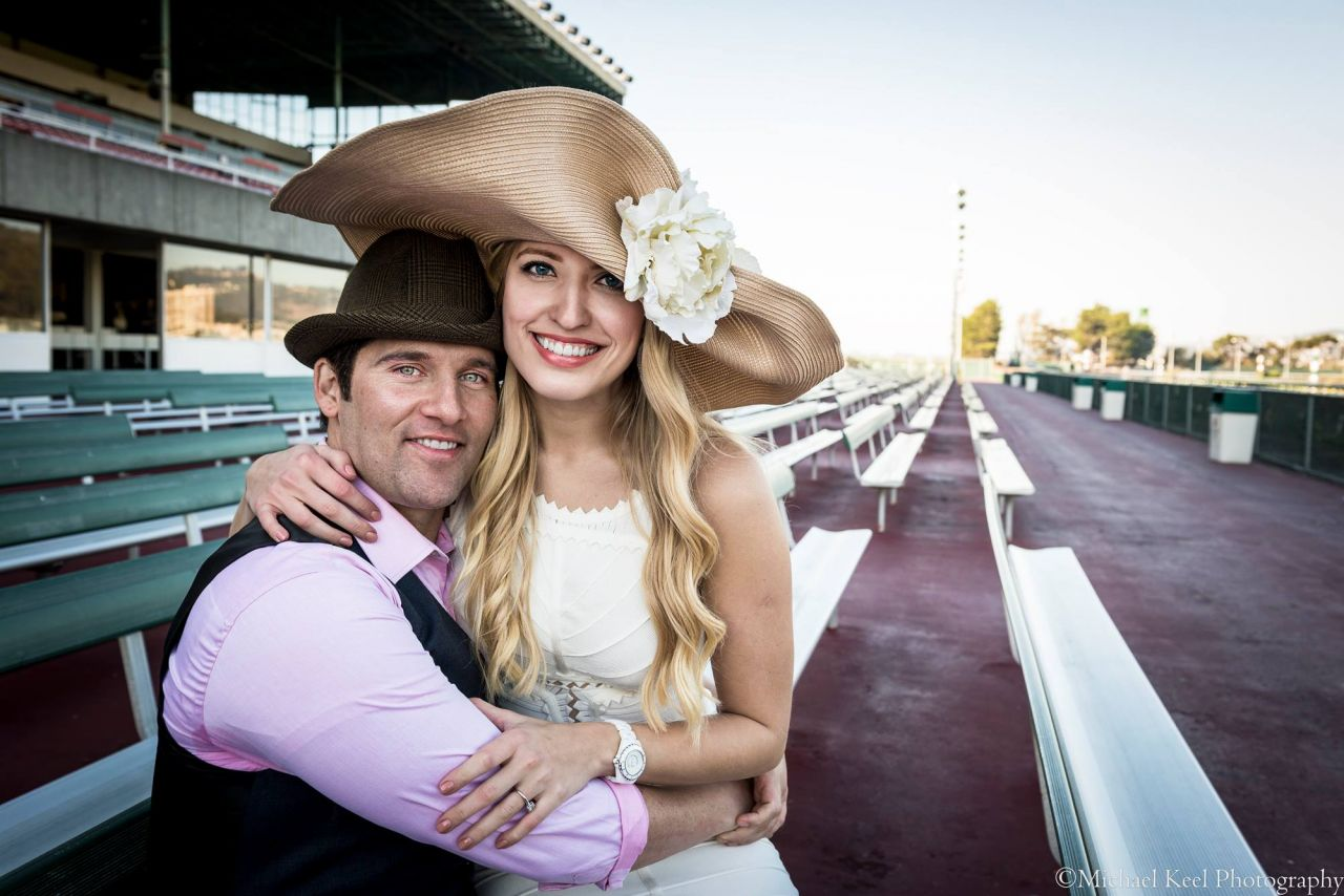 All you need is… a lovely hat and your beloved at a racetrack.