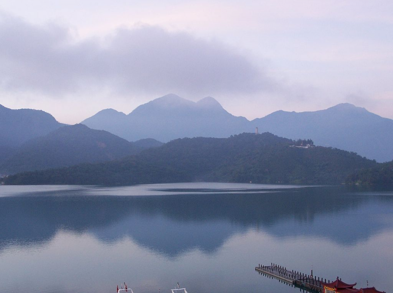 The Sun Moon Lake is surrounded by mountains.