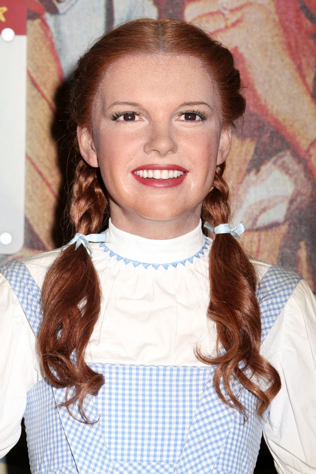 At the age of 16, Judy Garland's role won her an Oscar Juvenile Award at the 1939 Academy Awards, which she nicknamed the 'Munchkin Award'. Pictured is a wax figure of Garland's Dorothy on display at Madame Tussauds, New York City.