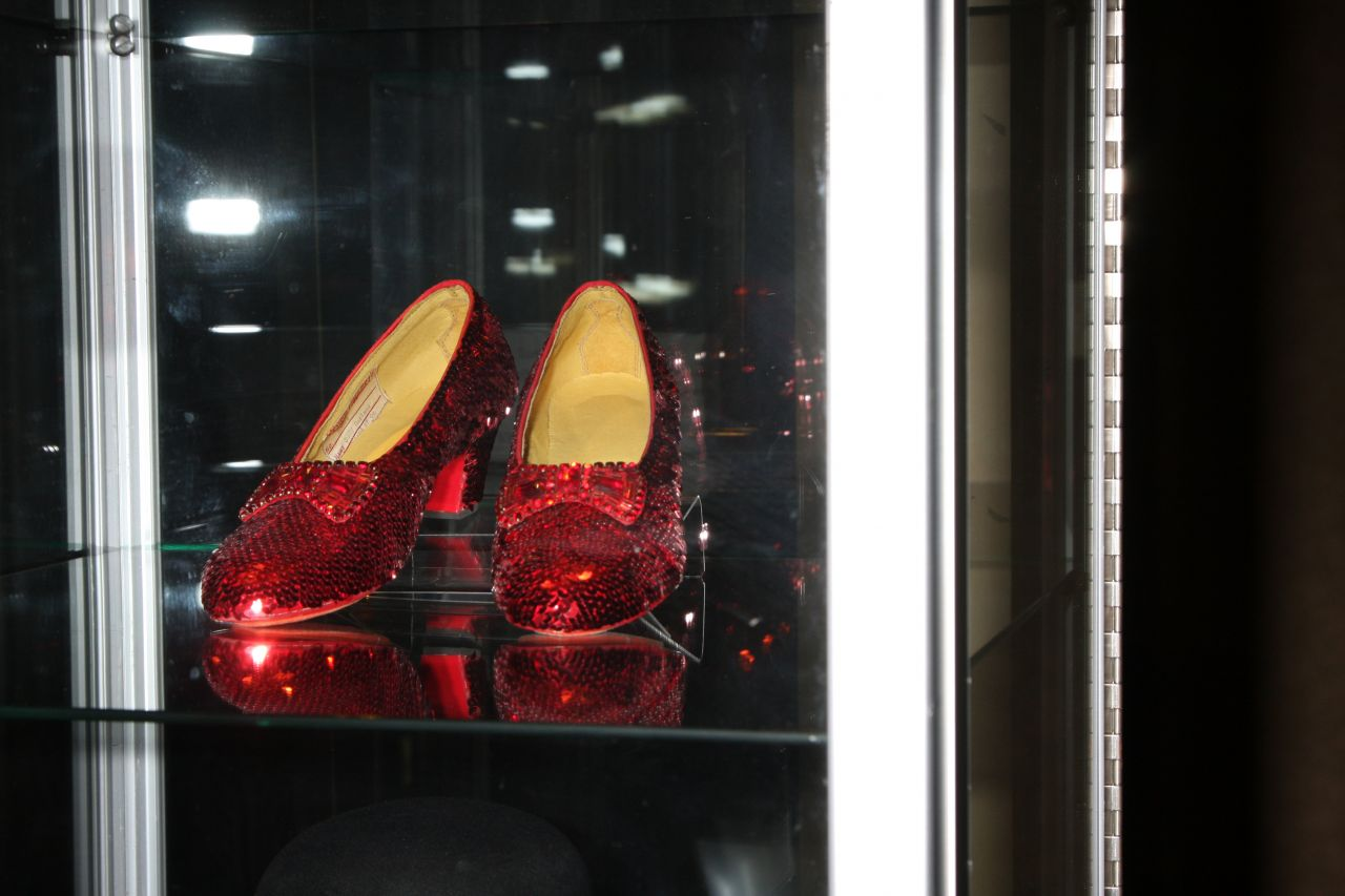 A mismatched pair of the iconic ruby slippers (silver in book) is currently on display in the Smithsonian Institution. Of the seven pairs made for the film, currently the whereabouts of only five are known. These were made for actress Debbie Reynolds.