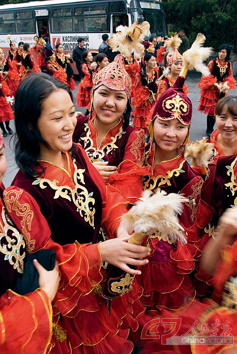 Young Kazakh women in traditional dress. Like other locales in Central Asia, Kazakhstan will benefit from the Silk Road Economic Belt.