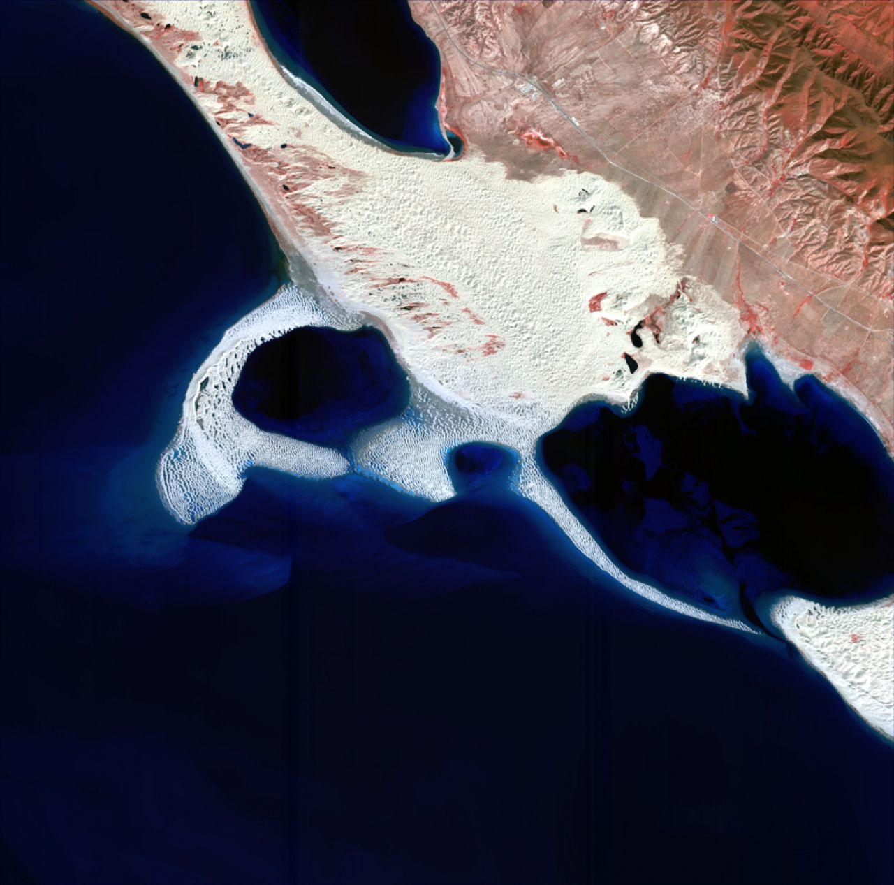 "A ""kiss"" at the northeast corner of Qinghai Lake, Qinghai Province. The white areas indicate sand."
