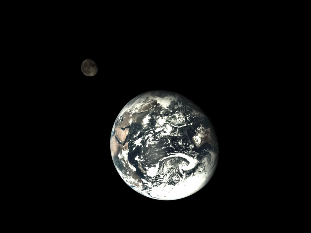 A shot of the Earth and Moon taken by the service module of the Chang'e-5 T1 lunar return mission.