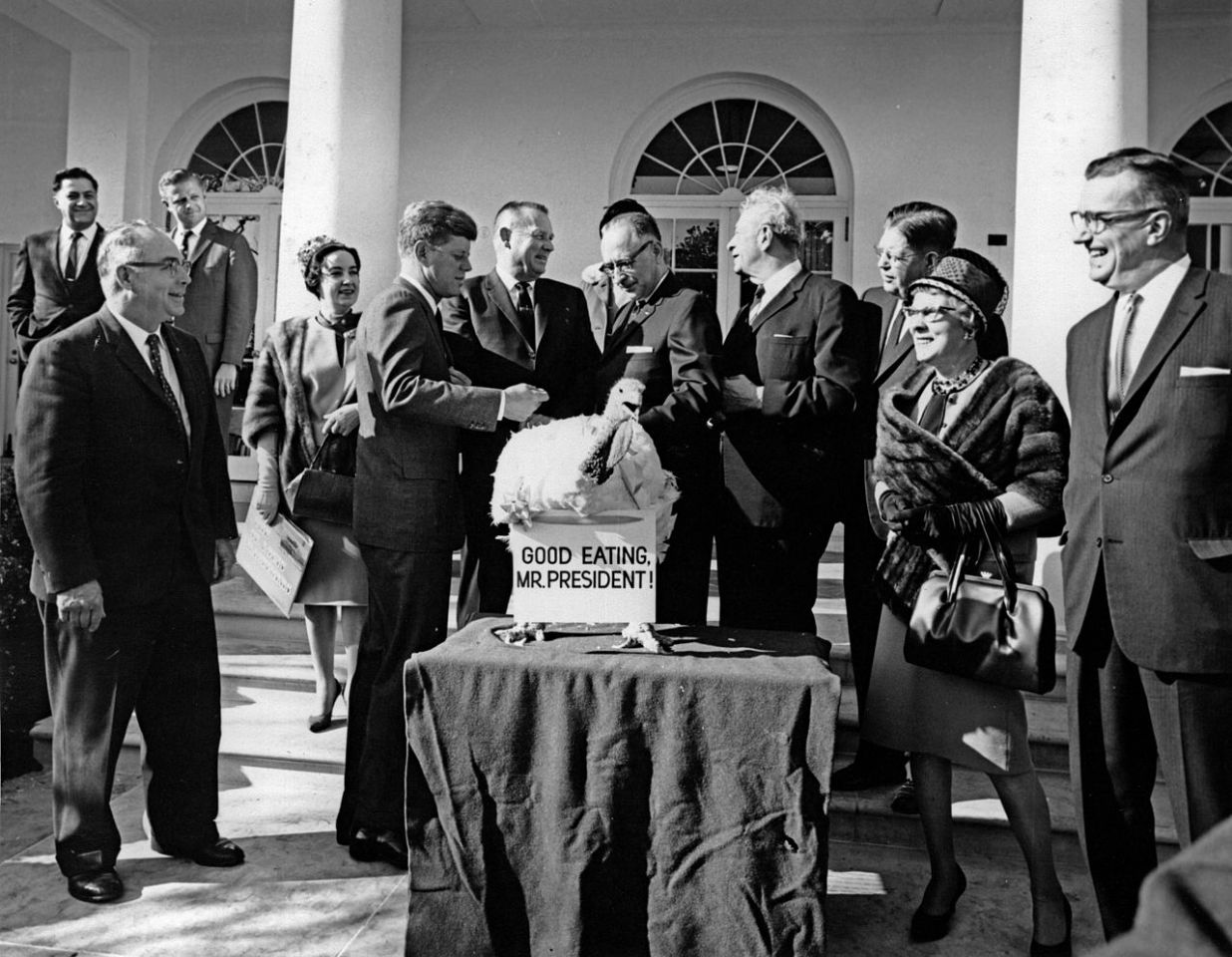 George Bush Sr was the first to officially pardon the White House Thanksgiving turkey from the National Turkey Federation. Here, John F. Kennedy unofficially pardons the bird three days before his death in Dallas.