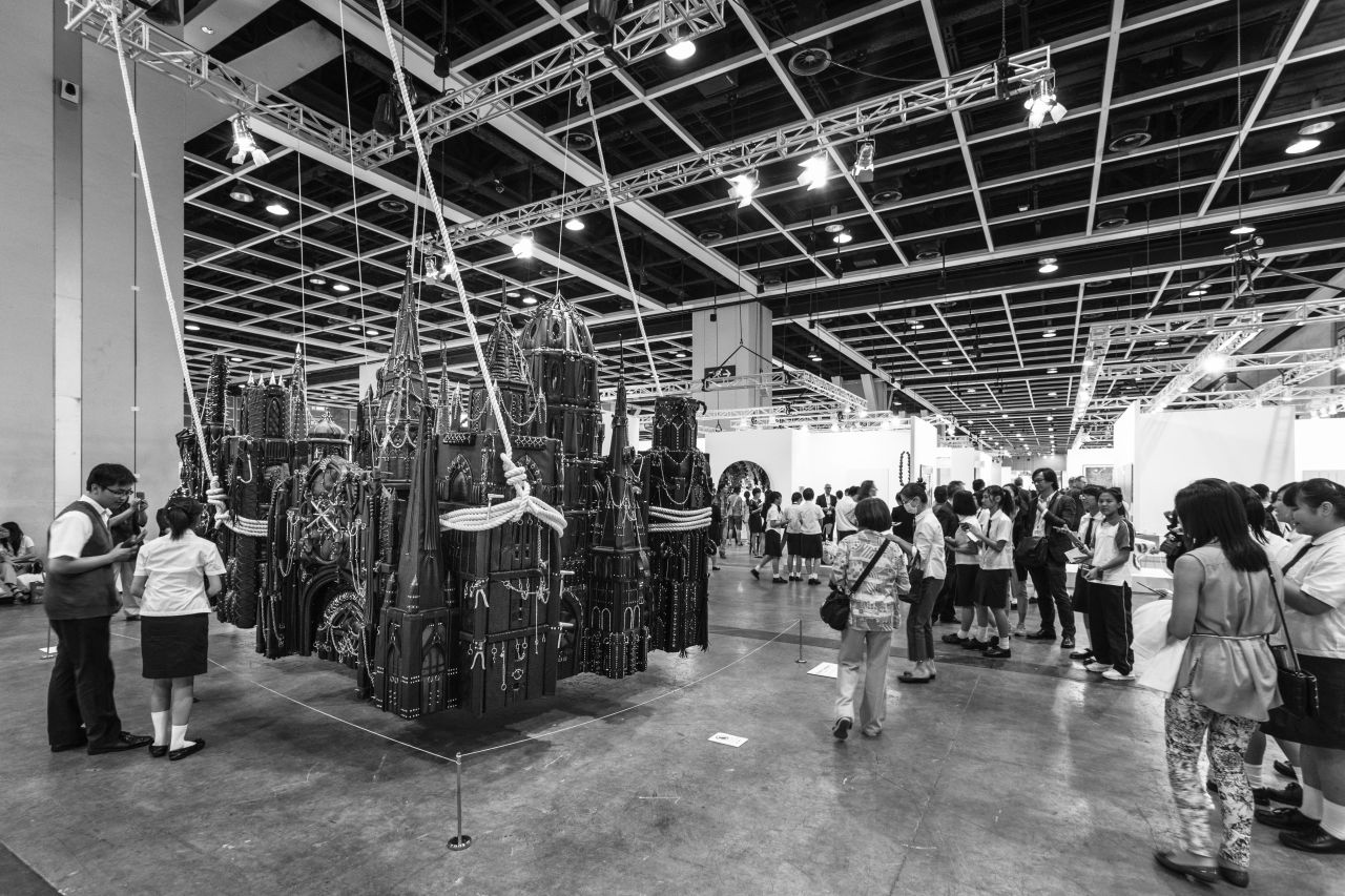 A leather fetish installation and high school students on view at the Art Basel Hong Kong in 2013.