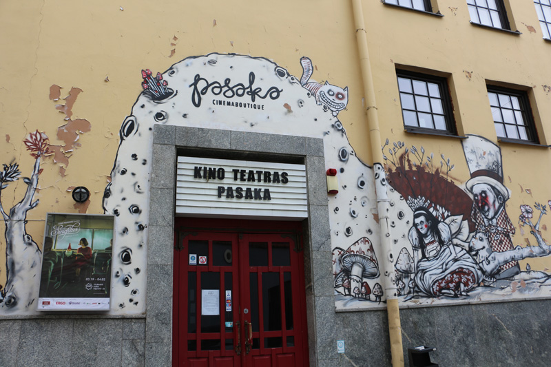 """Cinema boutique """"Pasaka"""", one of Vilnius' best independent cinemas, is one of the Kino Pavasaris hosts. The walls of the building are decorated with street graffiti."""