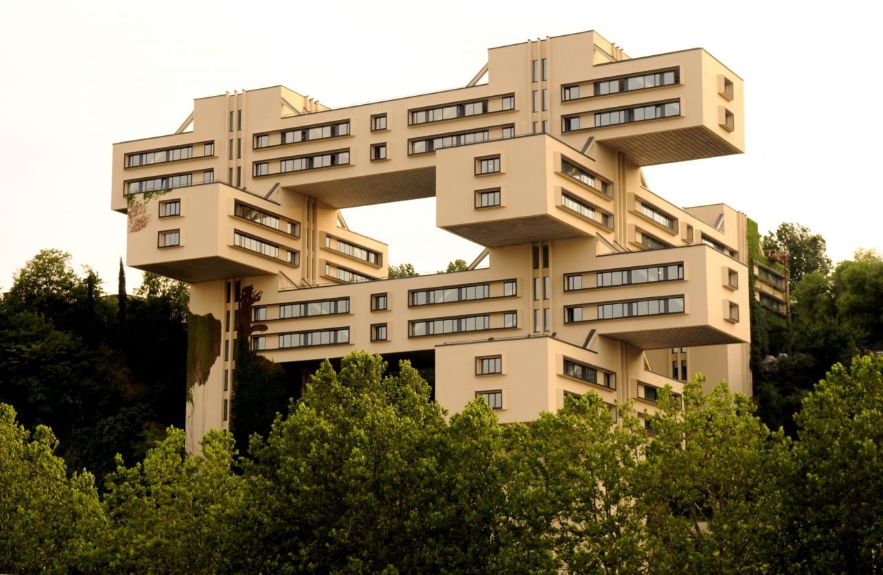 "The Bank of Georgia headquarters, situated on the right bank of Mtkvari River in Tbilisi, consists of a monumental grid of interlocking concrete forms built in a ""post-constructivist"" style."