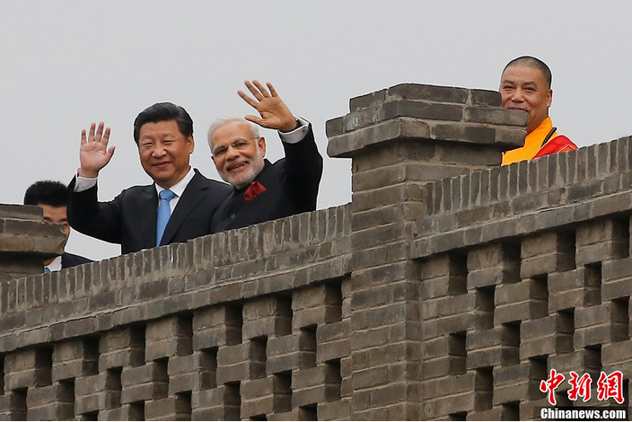 Chinese President Xi Jinping accompanies Indian Prime Minister Narendra Modi to the Da Ci'en Temple after their meeting in Xi'an, capital of northwest China's Shaanxi Province, May 14, 2015.