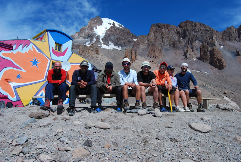 Alpinists taking a short break and savoring the beauty of their surroundings