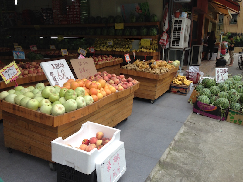 Shopping for fruits and vegetables in the open air is distinctive to summertime activities