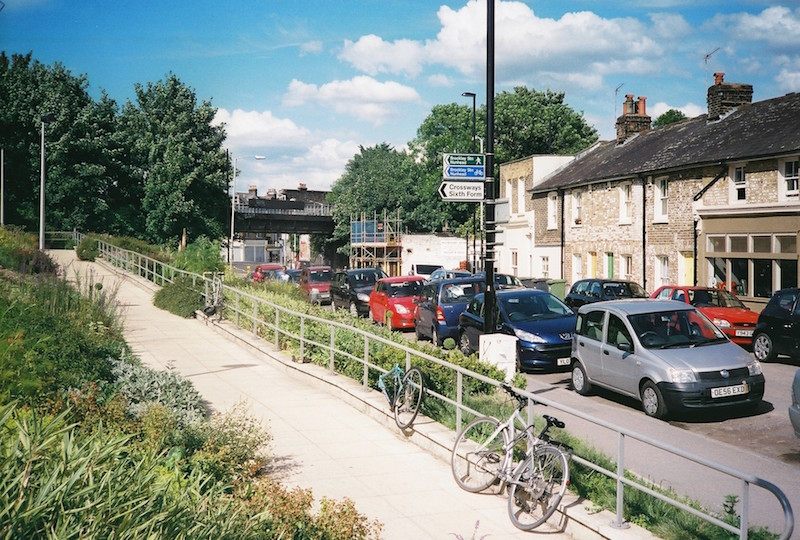 Cars line up on both side of the street in Brockley, London