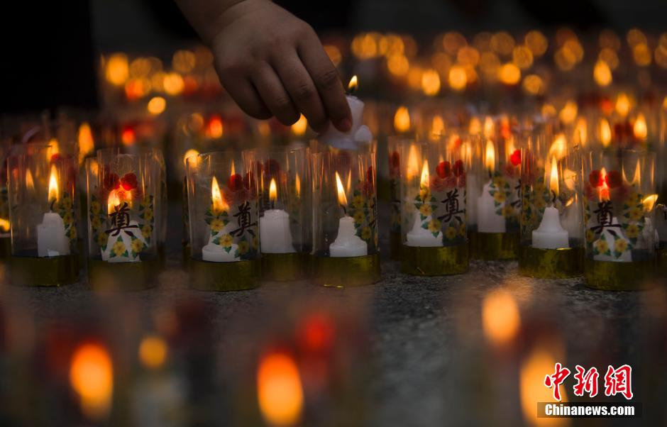 People lighted candles on Tuesday for the victims killed in the blasts.