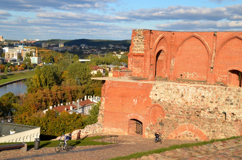 Bikers near the remnants of the medieval castle on the Hill of Gediminas