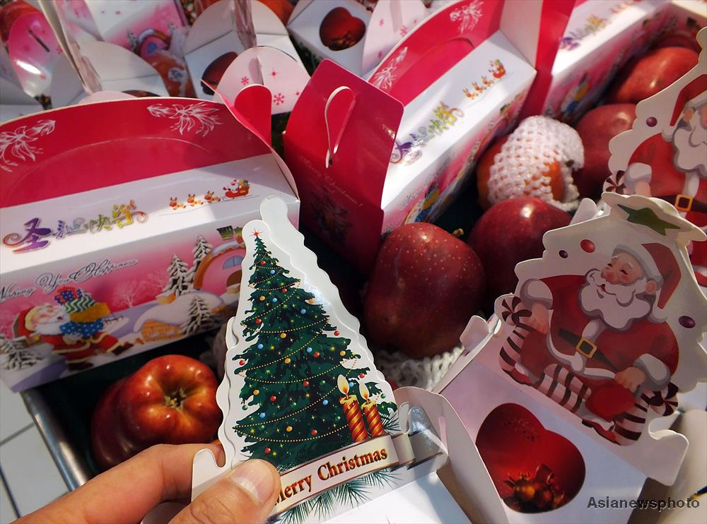 The majority of Christmas apples are red because it shares the colour of Santa Claus and the colour also fits pretty well with the green Christmas tree.