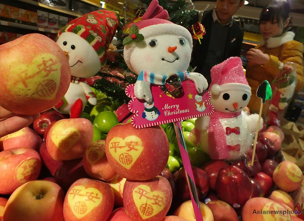 Well-wrapped apples and festive light wands are among the bestseller during Christmas in China.