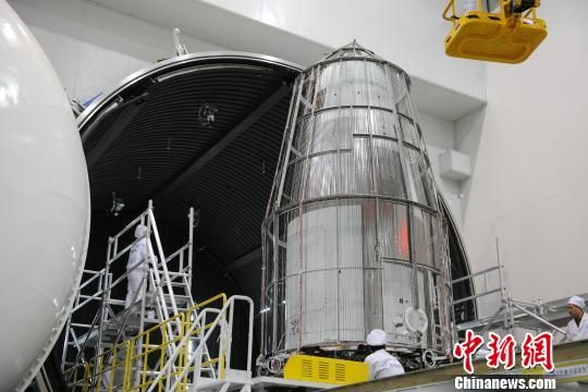 The Shijian-10 retrievable space science probe in vacuum chamber testing ahead of launch.