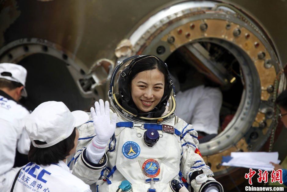China's Wang Yaping outside the Shenzhou-10 return capsule after two weeks in space in June 2013.