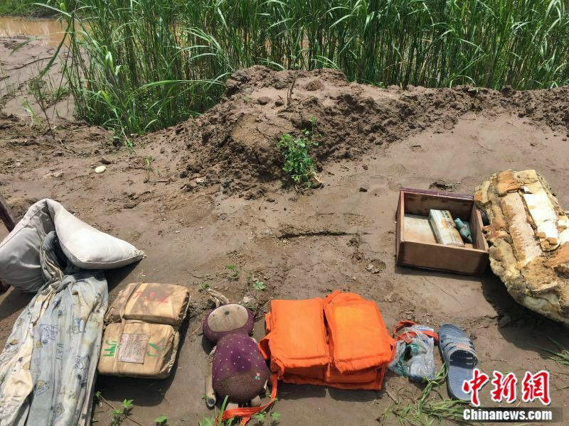 Salvaged objects belonging to the passengers of the capsized ship were laid out on the bank of the dam.