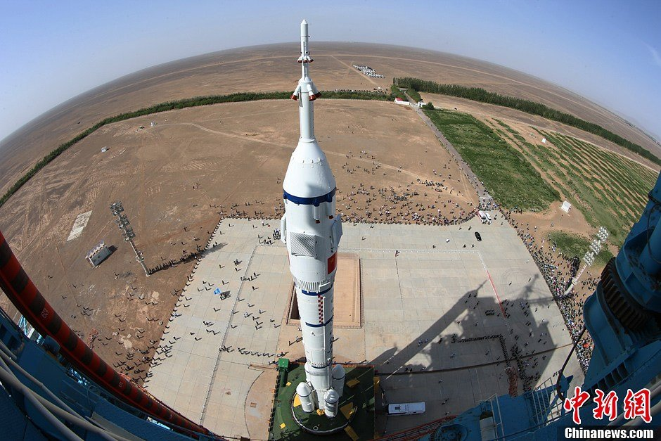 Shenzhou-10 within payload fairing and topped with a launch escape system, atop the Long March 2F rocket at the Jiuquan Satellite Launch Centre in June 2013.
