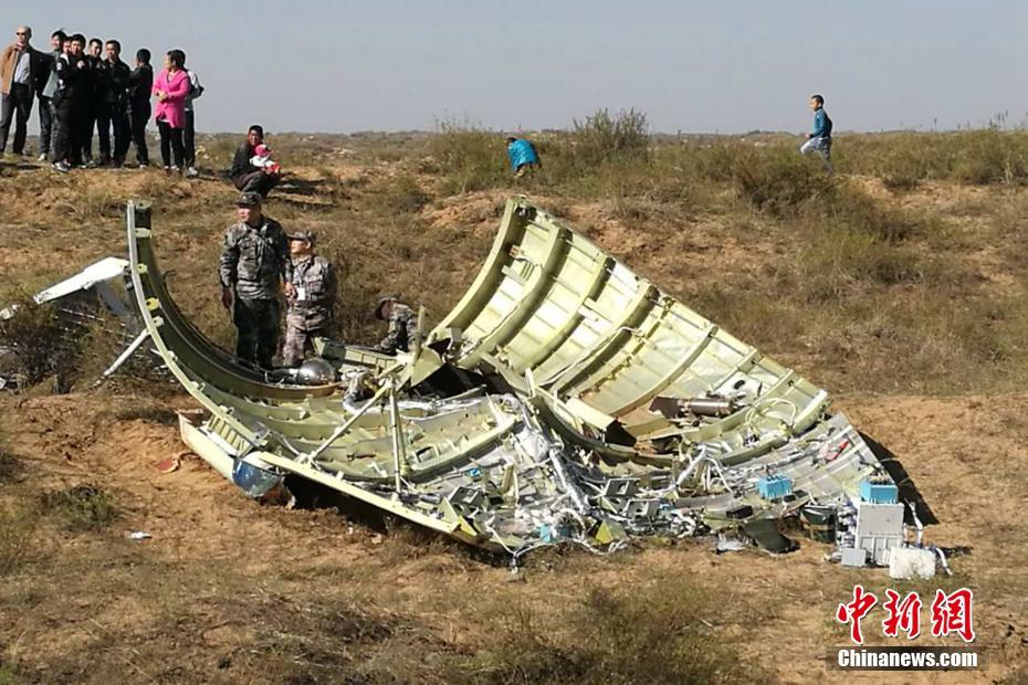 The payload fairing for China's Shenzhou-11 crewed space mission lands in an uninhabited area belonging to Yulin city in Shaanxi Province.