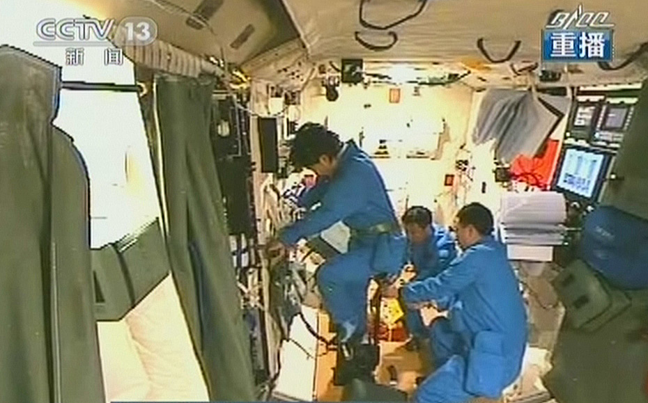 Liu Yang, China's first female in space, using the exercise bike aboard Tiangong-1 during the 2012 Shenzhou-9 mission.