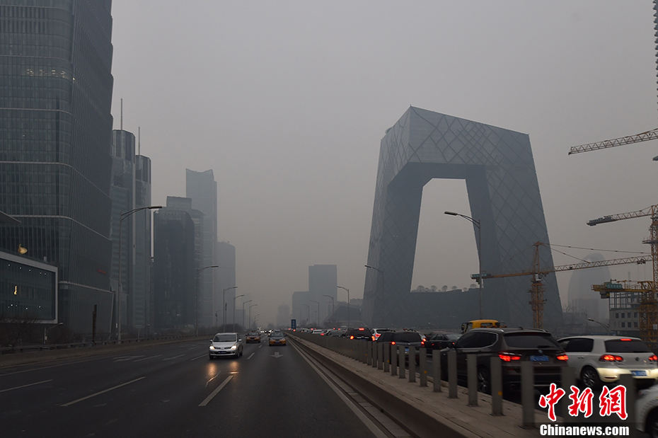 The China Central Television (CCTV) 'Big Pants' building in Beijing shrouded in smog on Monday, December 12, 2016.