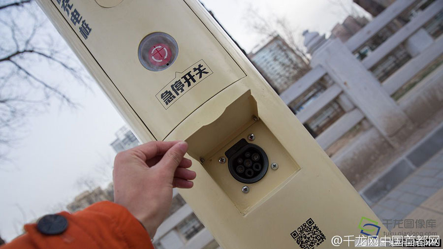 Beijing launches smart street light electric car chargers.