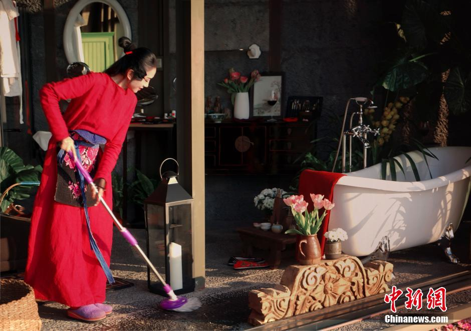 """People carry out the traditional house cleaning ahead of the Spring Festival. It's called """"sweeping the dust"""", and is believed to rid houses of bad luck and welcome in a new year."""