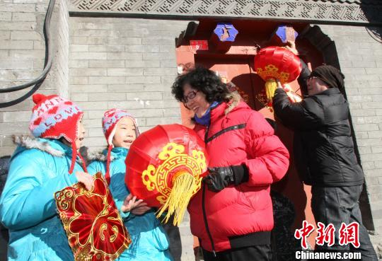 People decorate their houses before the Spring Festival, putting up red decorations like lanterns and paper cuttings. Red symbolises luck and happiness in Chinese traditional culture.