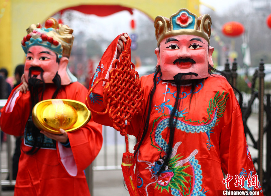 People set off firecrackers to welcome the God of Wealth on the fifth day of the New Year, hoping he will bring fortune in the new year.