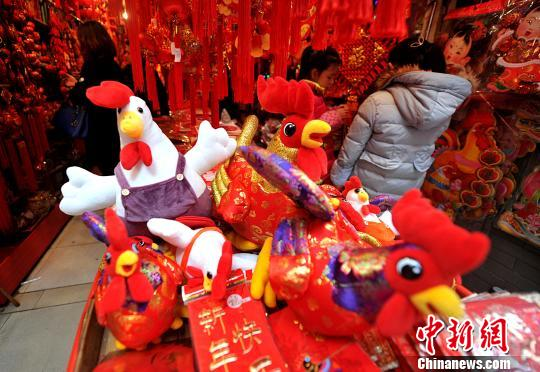 People purchase food, snacks, clothes and decorations in preparation for the Chinese New Year.