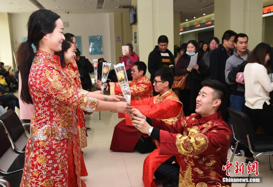 Newly married couples mixing traditional Chinese dress with the western Valentine's Day.