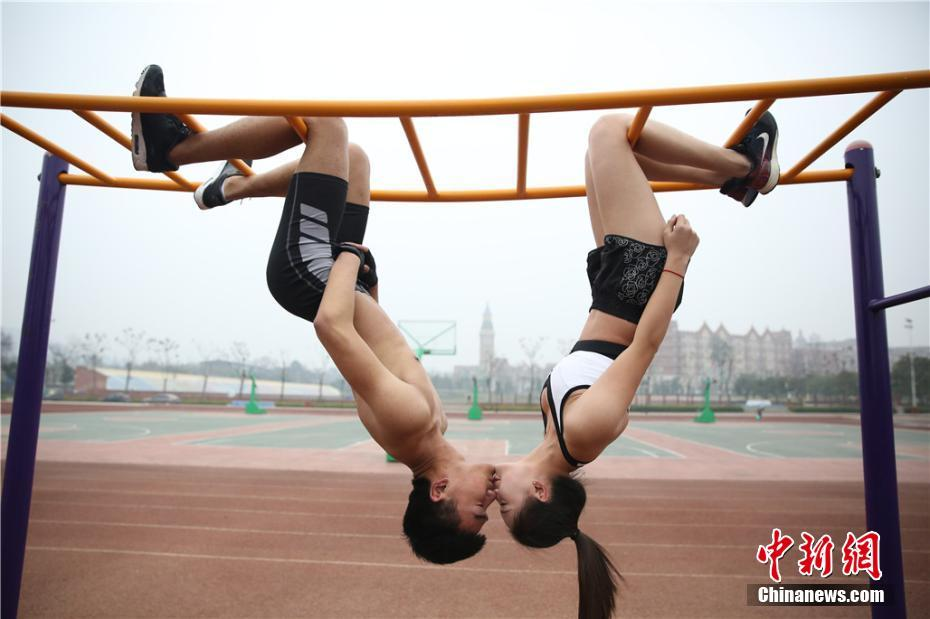 Two aviation students at a Sichuan university show the strength and commitment of their relationship with a hanging kiss.