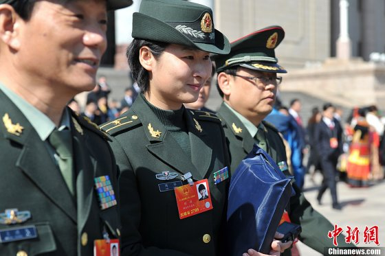 Liu Yang, a People's Liberation Army Air Force major before becoming an astronaut, outside the Great Hall of the People in Beijing in March 2013.