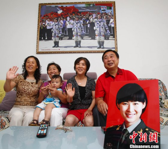 Liu Yang's family talk to their history-making astronaut in orbit during Dragon Boat Festival.