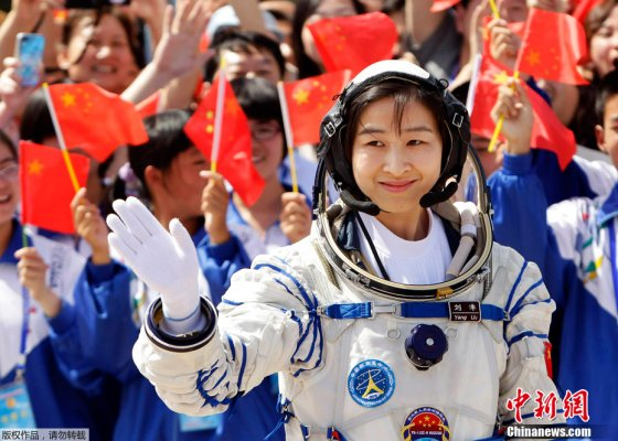 Liu Yang waves ahead of launch on Shenzhou-9 from the Jiuquan launch centre on June 16, 2012.