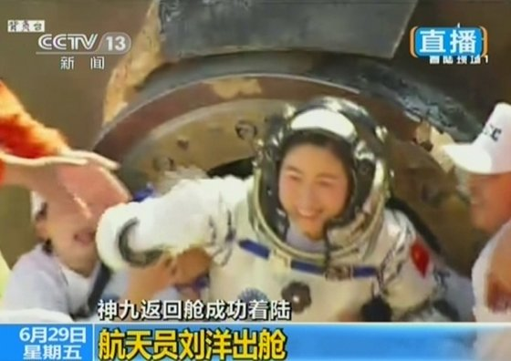 Liu Yang emerges from the Shenzhou-9 return capsule at Siziwang Banner in Inner Mongolia on June 29, 2012.