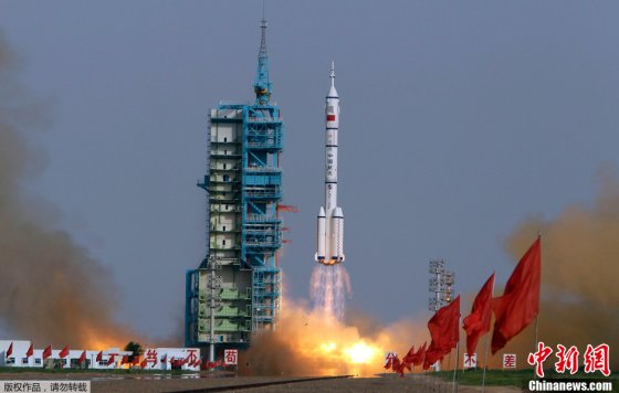 Shenzhou-9 lifts off on top of a Long March 2F rocket from the Jiuquan Satellite Launch Centre in the Gobi Desert on June 16, 2012.